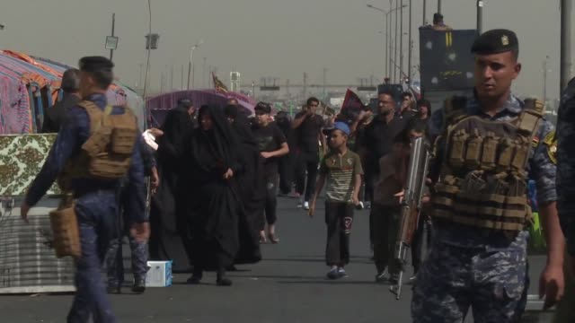thousands of pilgrims begin the 90 km walk from baghdad to the holy city of karbala for the arbaeen religious festival which commemorates the seventh... - karbala stock videos & royalty-free footage