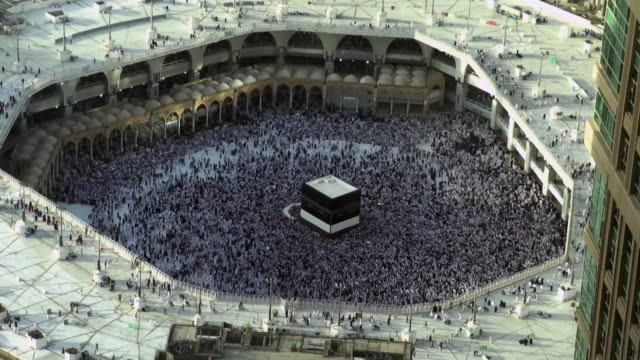 thousands of pilgrims gather at the grand mosque of mecca islam's holiest site to walk around the kaaba in a counterclockwise direction as part of... - grand mosque stock videos and b-roll footage