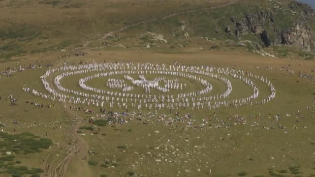 thousands of pilgrims gather in bulgaria's rila mountains to welcome their spiritual new year with a cosmic like dance performed in concentric... - concentric stock videos and b-roll footage