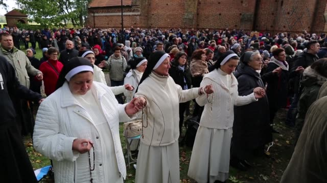 Thousands of Polish Catholics form human chains on the country's borders begging God to save Poland and the world in an event many viewed as a...