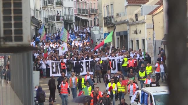 thousands of portuguese police officers march through lisbon to demand better pay and conditions in the first major protest since the socialists were... - portugal stock videos & royalty-free footage