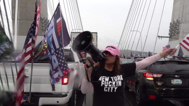 thousands of pro trump supporters caravan vehicles with maga flags on upstate new york highways blocking traffic and shutting down two major bridges,... - convoy stock videos & royalty-free footage
