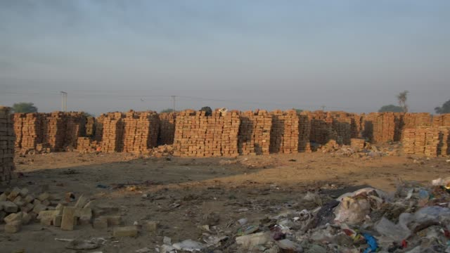 thousands of produced bricks at a local brick kiln factory punjab, pakistan - brick stock videos & royalty-free footage
