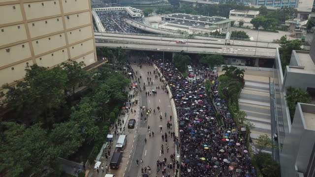Thousands of protesters gathered at Tsun Yip Street Playground and had a peaceful marched across Kwun Tong