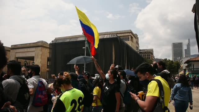 thousands of protesters in colombia took to the streets on saturday for international workers' day marches and protested against a government tax... - colombia stock videos & royalty-free footage