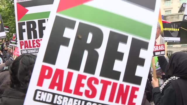 thousands of protesters in london march in support of palestinians, as the worst violence in years rages between israel and militants in gaza - occupation stock videos & royalty-free footage