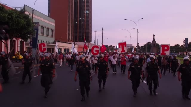 Thousands of protesters march against corruption through the streets of downtown Lima Peru on February 16 2017 Protesters arrived at the Palace of...