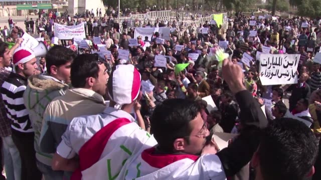 thousands of protesters massed friday in cities and towns across iraq after streaming in on foot in defiance of vehicle bans for rallies over... - iraq stock videos & royalty-free footage