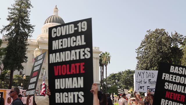 thousands of protesters opposing vaccine mandates march past the capitol building in sacramento as lawmakers do not gain enough support to advance... - 10 seconds or greater stock videos & royalty-free footage