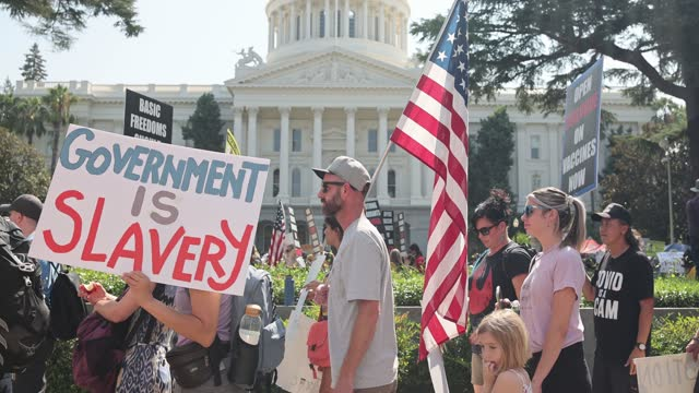 thousands of protesters opposing vaccine mandates march past the capitol building in sacramento as lawmakers do not gain enough support to advance... - 1 minute or greater stock videos & royalty-free footage