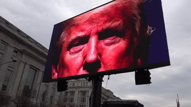 "thousands of protesters watch in freedom plaza as a donald trump campaign video is projected on jumbrotron while a crowd chants ""usa"" as the capitol... - washington dc stock videos & royalty-free footage"