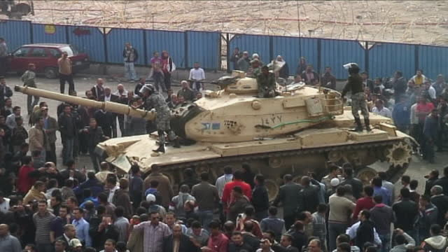 thousands of protestors gather in tahrir square for a second day on january 29, 2011 in cairo, egypt. the protests called for president hosni mubarak... - egypt stock videos & royalty-free footage