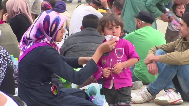 thousands of refugees and migrants are massed at the greek border with macedonia as new waves arrive on the islands before making their way across... - macedonia country stock videos and b-roll footage