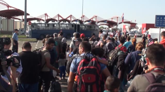 thousands of refugees arrived from croatia enter hungary as hungarian army members take security measures at hungariancroatian border on september 19... - osteuropäische kultur stock-videos und b-roll-filmmaterial