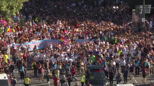 thousands of revellers take to the rainbow streets of madrid in the world's biggest march for gay lesbian bisexual and transgender rights - bisexuality stock videos and b-roll footage
