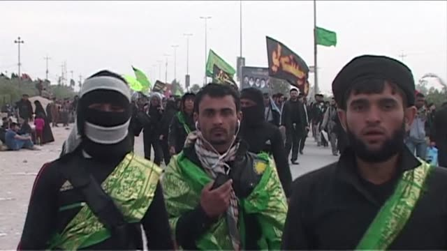 stockvideo's en b-roll-footage met thousands of shiite pilgrims in najaf were on their way to a religious commemoration in the holy city of karbala on thursday braving the threat of... - najaf