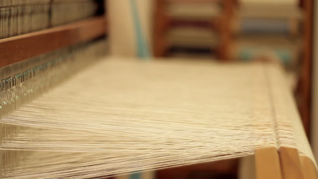 Thousands of string stretched on a weaving loom
