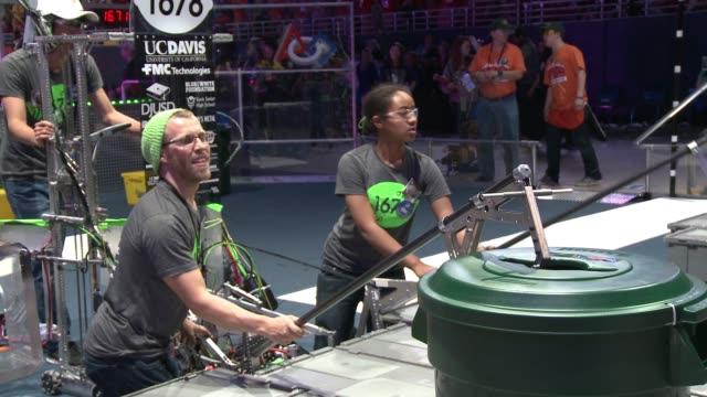 thousands of students show their engineering skills in st louis for annual first robotics championship / robots battle each other in recyclingthemed... - game show stock videos and b-roll footage