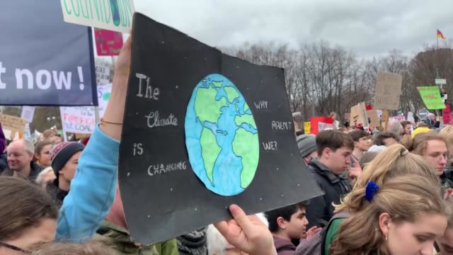 thousands of students take part in the 'friday for future' rally demanding more action on climate change in front of brandenburg gate in berlin... - friday stock videos & royalty-free footage