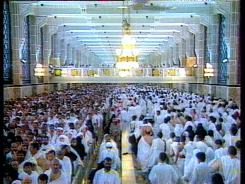 Thousands of Sunni Muslims dressed in traditional white Ihram garments file around Hajj for annual Pilgrimage to Mecca Saudi Arabia