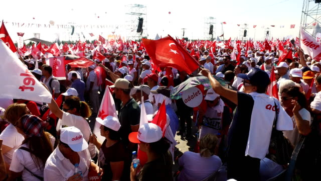 thousands of supporters cheer and wave flags while waiting for the start of the 'justice rally' held by turkey's main opposition republican people's... - justice concept stock videos & royalty-free footage