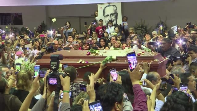 stockvideo's en b-roll-footage met thousands of supporters gather at the headquarters of alan garcia's party to pay their respects to the peruvian former president who died in the... - former