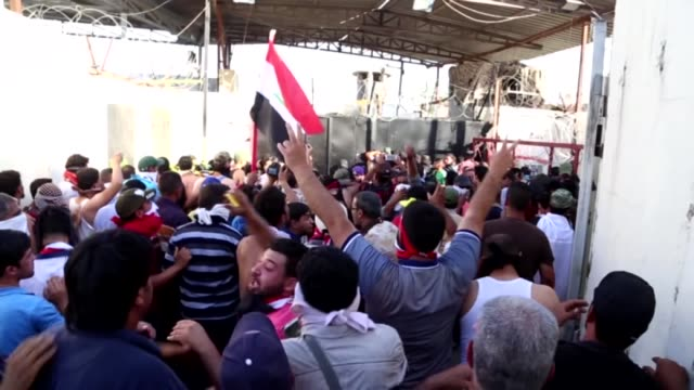 thousands of supporters of shia cleric muqtada alsadr storm baghdad's green zone which houses iraqi state institutions and foreign diplomatic... - muqtada al sadr stock videos & royalty-free footage