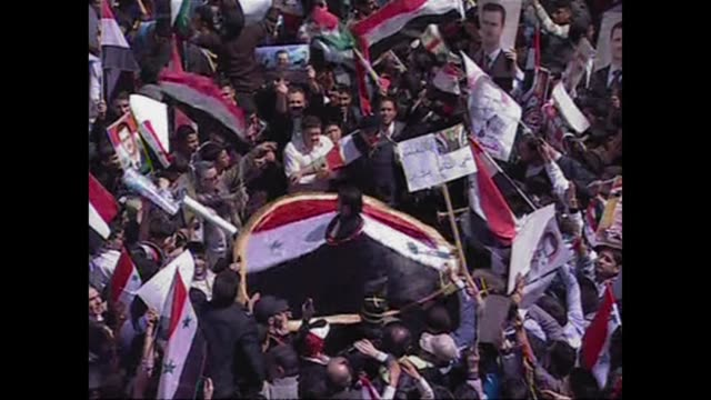 thousands of supporters of syrian president bashar alassad poured into central damascus in a show of support for their leader who is facing... - syria stock videos & royalty-free footage