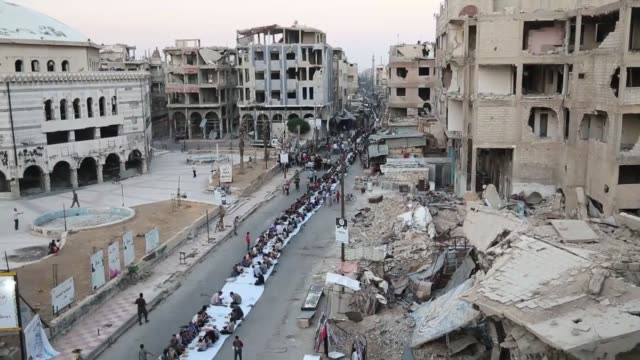 thousands of syrian muslims break their fast on a onekmlong stretch amidst the rubble of their homes near grand mosque in the besieged oppositionheld... - grand mosque stock videos and b-roll footage