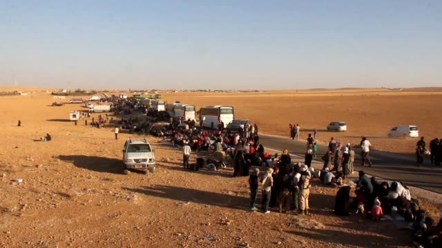 thousands of syrian refugees and rebels evacuated from northeastern lebanon arrive in central syria in territory held by rebel and jihadist fighters - refugee stock videos & royalty-free footage