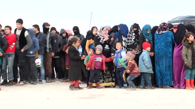 Thousands of Syrians braved the freezing cold at Turkeys border after fleeing a regime assault that threatens a new humanitarian disaster as Damascus...