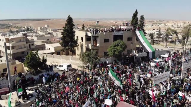 thousands of syrians demonstrate against the bashar al assad regime and call for the release of detainees in its prisons in the rebel held town of... - prison release stock videos & royalty-free footage