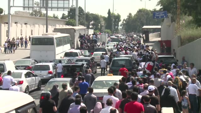 thousands of syrians filling the streets around their embassy in beirut turned out to vote wednesday in syrias controversial presidential poll being... - lebanon country stock videos & royalty-free footage