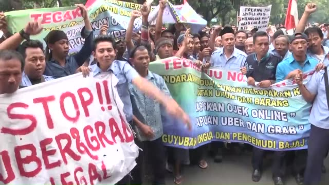 march 22: thousands of taxi drivers protest against transport apps such as uber and grab in jakarta, indonesia on march 22, 2016. - taxi stock videos & royalty-free footage