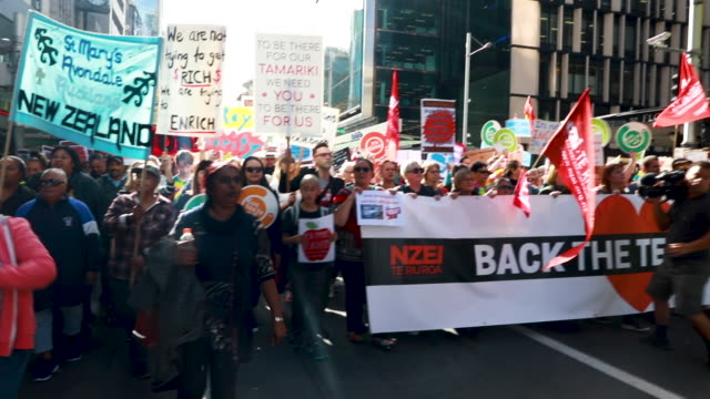 thousands of teachers, parents and school children march up queen street as they protest on may 29, 2019 in auckland, new zealand. some 50,000 school... - new zealand culture stock videos & royalty-free footage