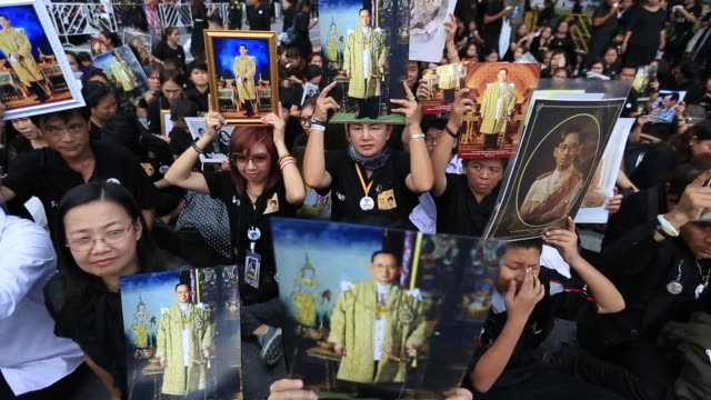 thousands of thai people gather at sanam luang front of the grand palace to pay homage for the late king bhumibol adulyadej on his 89th birthday in... - king of thailand stock videos and b-roll footage