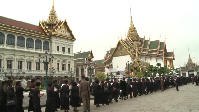 thousands of thais streamed into the gates of bangkoks grand palace as the public is granted its first chance to enter the throne hall where the body... - king of thailand stock videos and b-roll footage