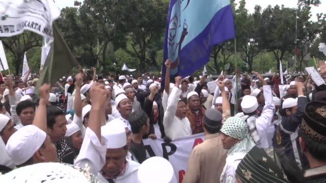 thousands of the hardline islamic defenders front member take part in a protest in jakarta, indonesia, on october 14, 2016 to show their disapproval... - out of context stock videos & royalty-free footage