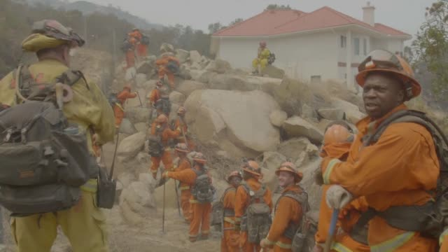thousands of volunteer inmate firefighters are helping in the battle against the largest wildfires in california's history - prisoner stock videos and b-roll footage