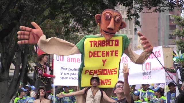 Thousands of workers trade unions students teachers and indigenous people march in the streets of Colombia's capital against the policies of...