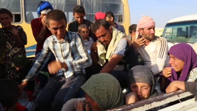 Thousands of Yezidis trapped in the Sinjar mountains without food and water for days as they tried to escape from Islamic State forces are rescued by...