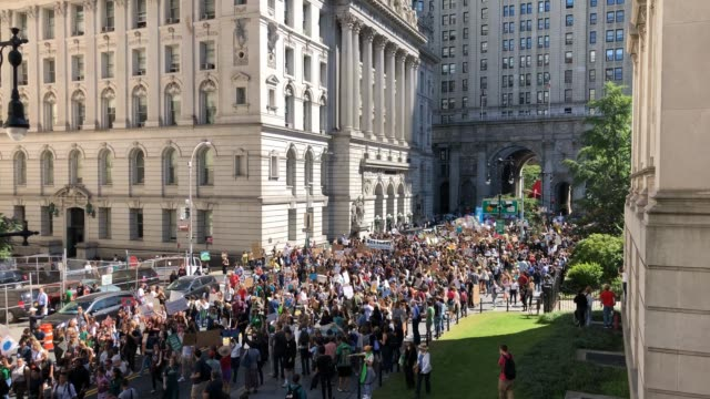 thousands of young activists and their supporters rally for action on climate change on september 20 2019 in new york city thousands of young people... - strike protest action stock videos and b-roll footage