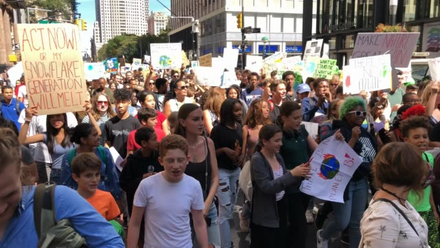 thousands of young activists and their supporters rally for action on climate change on september 20 2019 in new york city thousands of young people... - climate action stock videos & royalty-free footage