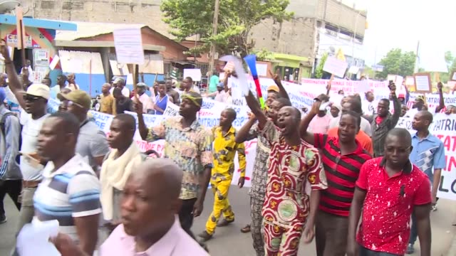 thousands protest in benin's capital contonou against a proposed new constitution - benin stock videos and b-roll footage