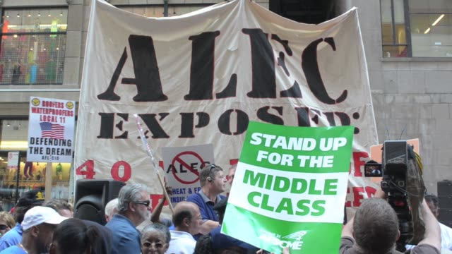 / Thousands protest outside the Palmer House Hilton Hotel where The American Legislative Exchange Council hold their 40th anniversary convention /...