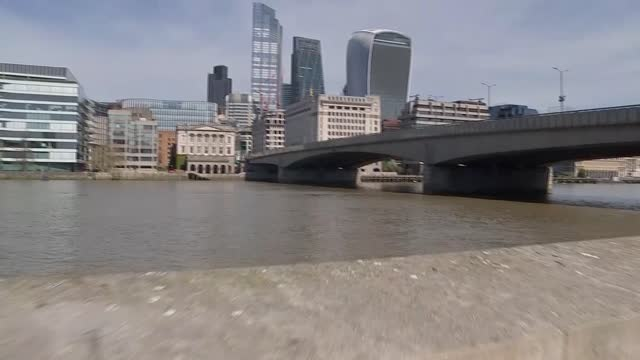 thousands raised for family of man who died saving woman from thames; england: london: london bridge: ext gv floral tributes by bank wall of thames... - men stock videos & royalty-free footage