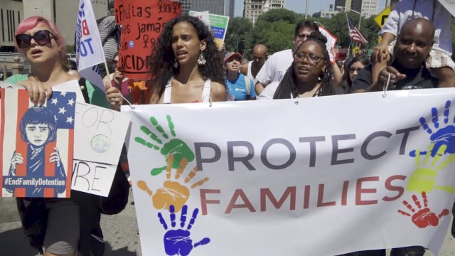 thousands rallied for the 'families belong together' in downtown manhattan's foley square and marched across the brooklyn bridge and rallied once... - separation stock videos and b-roll footage