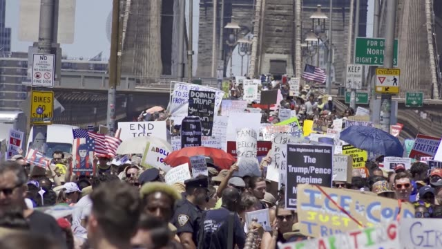 Thousands rallied for the 'Families Belong Together' in downtown Manhattan's Foley Square and marched across the Brooklyn Bridge and rallied once...