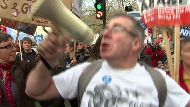 thousands take to streets in london to protest nhs cuts 'no cuts' placard jacqui berry interview sot protester with megaphone natalie radcliffe... - radcliffe camera stock videos and b-roll footage