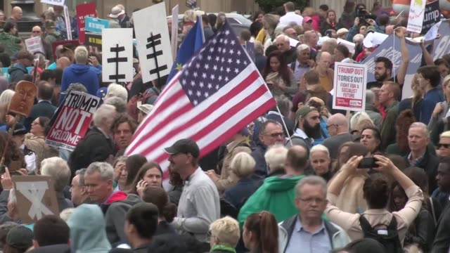 thousands take to the streets of central london to protest the visit of us president donald trump with the infamous blimp of the us president once... - infamous stock videos & royalty-free footage